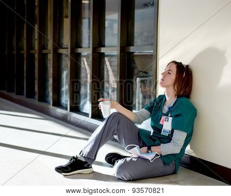 Exhausted Nurse Sitting On The Floor