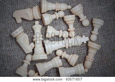 White chess pieces on burlap
