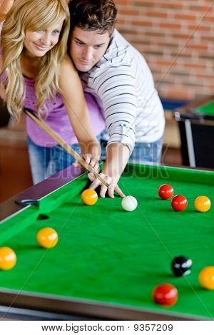 Affectionate Boyfriend Learning His Girlfriend How To Play Pool