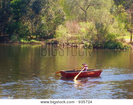 Child In Rowboat