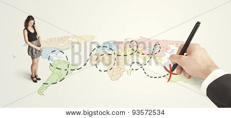 Businesswoman looking at map and route drawn by hand concept on background