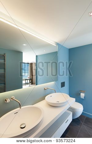 Interior, modern apartment, blue bathroom with two sinks