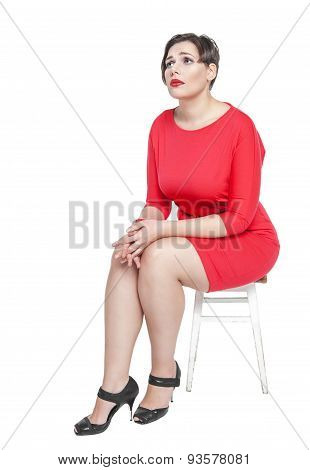 Sad Plus Size Woman Sitting On The Chair Isolated