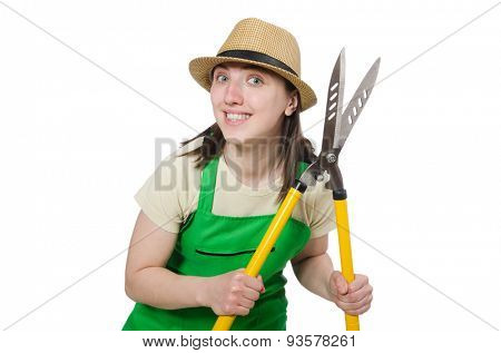 Young woman with shears on white