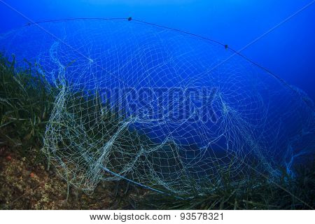 Abandoned fishing net underwater causes environmental problem and pollution