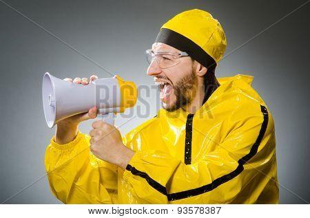 Man in yellow suit and loudspeaker