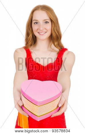 Young nice girl with giftbox isolated on white
