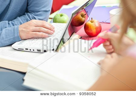 Close-up Of Two Serious Teenagers Studying