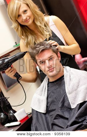 Professional Female Hairdresser Drying Her Customer's Hair