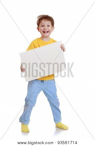 Laughing little boy is holding in front of a rectangular white p