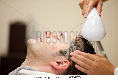 Close-up Of A Young Man Having His Hair Washed