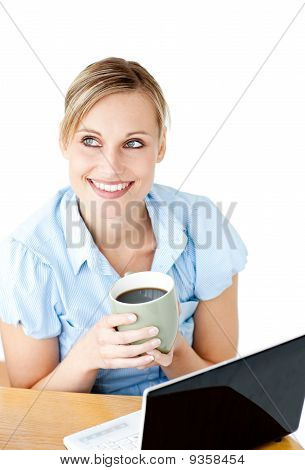 Glowing Businesswoman Drinking Coffee Smiling At The Camera Sitting