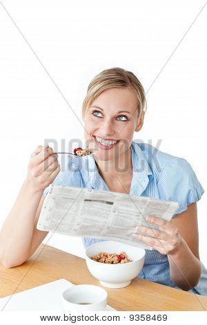 Glowing Businesswoman Having Breakfast And Reading A Newspaper Sitting