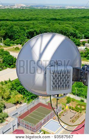 Antenna Cellular Base Station Against The Blue Sky