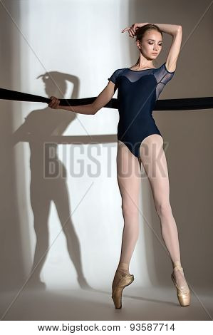 Portrait of the young ballerina in a studio