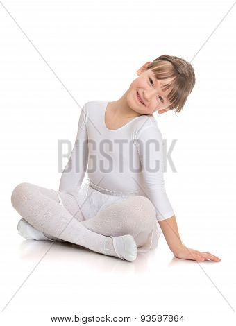Charming girl athlete sits on the floor folded in Turkish feet