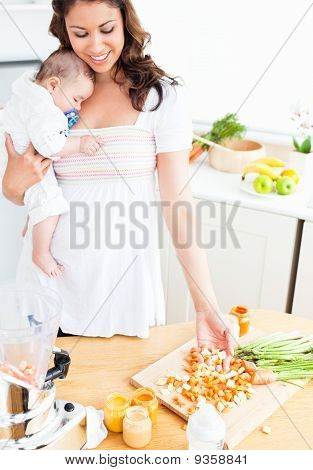 Radiant Mother Preparing Food For Her Adorable Baby In The Kitchen