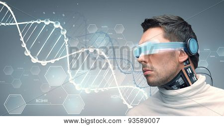 people, technology, future and progress - man with futuristic glasses and microchip implant or sensors over gray background and dna molecules with chemical formulas