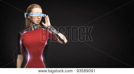 people, technology, future and progress - young woman with futuristic glasses and microchip implant or sensors over black background