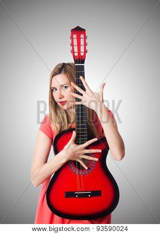 Female guitar player against the gradient
