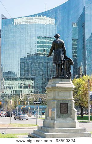 Back view of statue of John A. MacDonald looking the Downtown Core