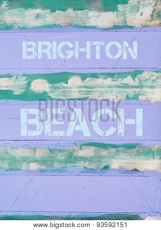 Brighton Beach Written On Vintage Painted Wooden Wall