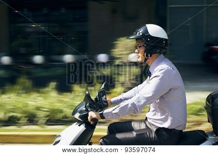 Chinese Businessman Commuter Riding Scooter Motorcycle In City