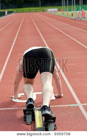 Sporty Man Waiting In Starting Block