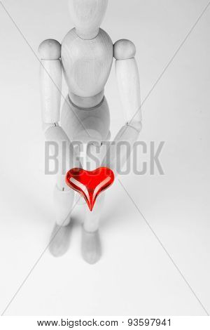 Classic wooden dummy holds red little heart