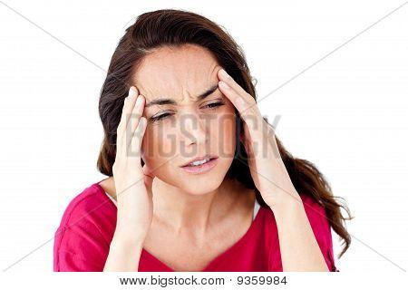 Downcast mulher hispânica, tendo uma dor de cabeça