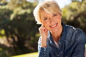 pic of close-up middle-aged woman  - closeup portrait of middle aged woman outdoors - JPG