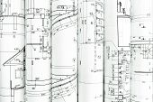 stock photo of architecture  - rolls of architecture blueprints and technical drawings architectural background - JPG