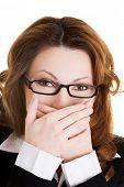 picture of shame  - Businesswoman covering her mouth because of shame - JPG
