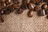 foto of sackcloth  - Frame of coffee beans on sackcloth background - JPG