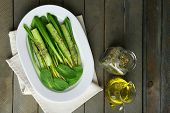 foto of leek  - Green salad with cucumber and wild leek on wooden background - JPG