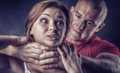 stock photo of strangle  - Domestic violence woman being abused and strangled by strong man - JPG