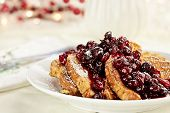 pic of french toast  - Cranberry sauce made with maple syrup butter and fresh cranberries over delicious golden french toast for Christmas morning - JPG