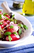 stock photo of sesame seed  - Salad from a radish with sesame seeds in a white plate - JPG
