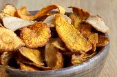 foto of parsnips  - Detail of fried carrot and parsnip chips in rustic wood bowl - JPG