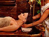 foto of ayurveda  - Woman having facial  ayurveda spa treatment - JPG