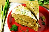 image of liver  - Liver pie two pieces on a plate with fresh herbs - JPG
