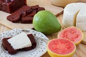 picture of juliet  - Brazilian dessert Romeo and Juliet on white plate goiabada and Minas cheese with fresh goiaba on wooden table - JPG