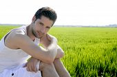 Young Man Outdoor Happy In Green Meadow