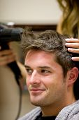 picture of hair cutting  - Female Hairdresser Drying Her Male Customer - JPG