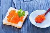 foto of banquette  - bread with caviar on the wooden table - JPG