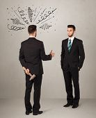 image of backstabbers  - Ruthless businessman handshake with a hiding weapon and drawn curly lines around his head - JPG