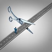 stock photo of scissors  - Work interruption concept and interrupted career path as a businessman on a road that is being cut by scissors as a layoff metaphor and symbol for job and employment limits or cutting benefits and opportunity for promotion or advancement - JPG
