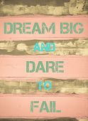 pic of daring  - Concept image of DREAM BIG AND DARE TO FAIL motivational quote written on vintage painted wooden wall - JPG