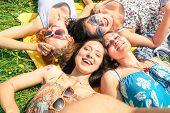 picture of selfie  - Multiracial girlfriends taking selfie at countryside picnic  - JPG