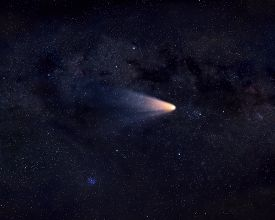 stock photo of comet  - Bright comet with wide tail flying in space - JPG